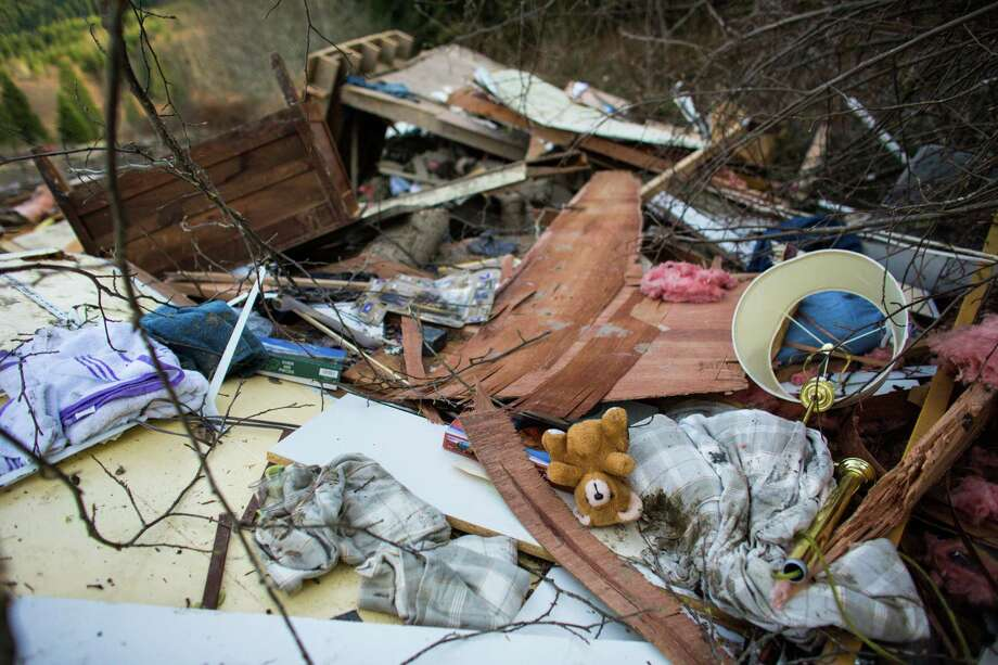 A teddy bear is shown in the wreckage of homes and lives destroyed by a mudslide near Oso, Wash. Photo: JOSHUA TRUJILLO, SEATTLEPI.COM / SEATTLEPI.COM