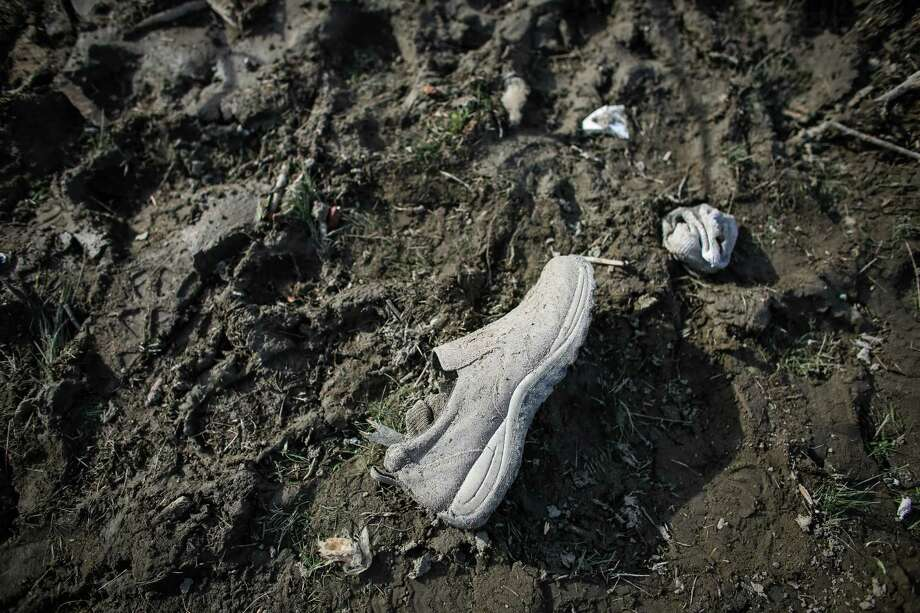 A shoe and socks are shown in the debris field. Photo: JOSHUA TRUJILLO, SEATTLEPI.COM / SEATTLEPI.COM