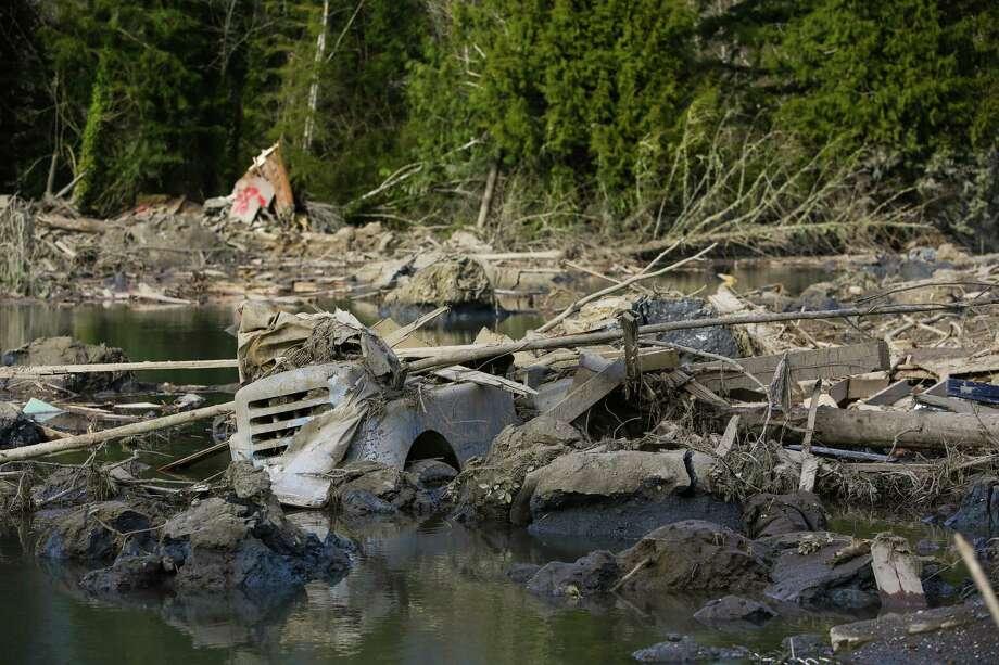A car is shown in the debris field. Photo: JOSHUA TRUJILLO, SEATTLEPI.COM / SEATTLEPI.COM