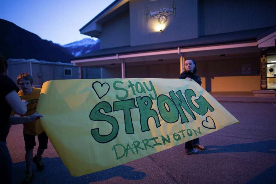 Shelby Stafford, 14, and Hailey Hudson, 17, hold a banner they made at Darrington High School. Photo: JOSHUA TRUJILLO, SEATTLEPI.COM / SEATTLEPI.COM