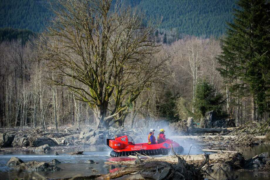 Rescue workers use a hover craft to search the debris field. Photo: JOSHUA TRUJILLO, SEATTLEPI.COM / SEATTLEPI.COM