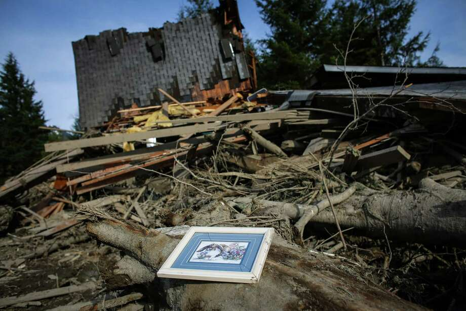 A framed picture sits among the wreckage of homes and lives. Photo: JOSHUA TRUJILLO, SEATTLEPI.COM / SEATTLEPI.COM