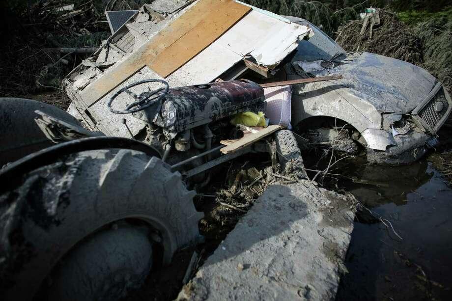 A car and tractor are shown in the debris field. Photo: JOSHUA TRUJILLO, SEATTLEPI.COM / SEATTLEPI.COM