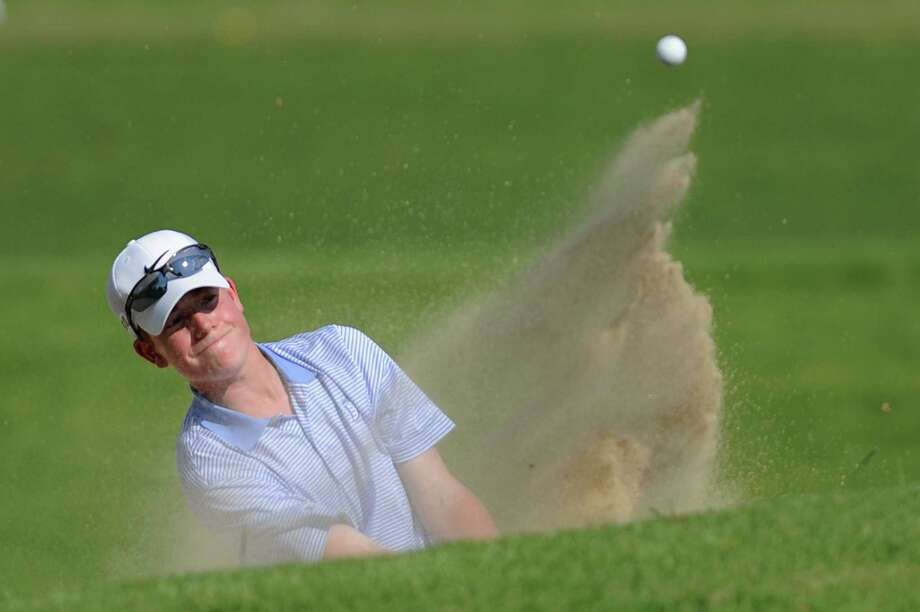 Darien's Christian Ostberg hits out of a bunker during the FCIAC Boys Golf Championship at at Heritage Village Country Club in Southbury, Conn. on Thursday, May 30, 2013.  Greenwich won with a team score of 312 and Darien placed second. Photo: Tyler Sizemore / The News-Times