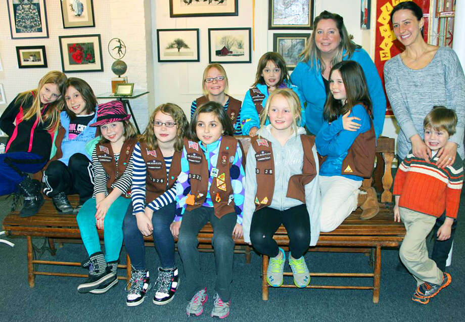 New Milford Brownie Girl Scout Troop 40228 and troop leaders, Leslie Sarich, second from right in back, and Joana Chiappa, back right, with Evan Chiappa, recently visited Gallery 25 and Creative Arts Studio in New Milford to complete requirements for a Painting Life Styles badge. The girls are, from left to right, in front, Ella Waiptoc, Lexi Donnelly, Abbey Sarich, Sydney Scalzo, Anna Debellis, Carly Lynch and Isabel Delpha, and in back, Emily Chiappa and Olivia Schulta.  Courtesy of Ellie Boyd Photo: Contributed Photo / The News-Times Contributed