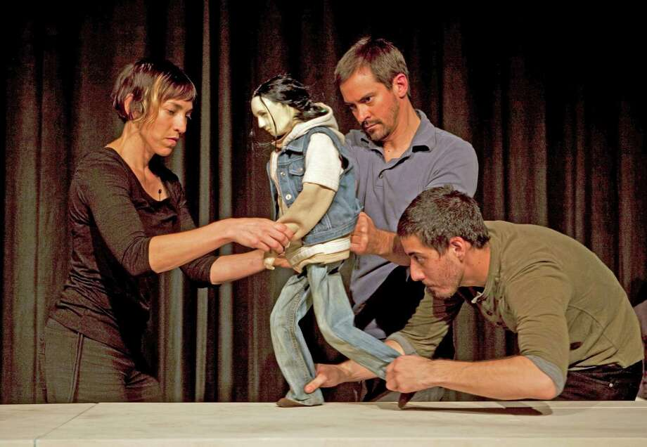 """Who's Hungry,"" an experimental table-top puppet theater play that aims to raise awareness of those who must choose between life's basic necessities, will be staged April 4 and 5 at the Silvermine Arts Center, 1037 Silvermine Road, New Canaan. From left, Rachael Lincoln, Darius Mannino, Zachary Tolchinsky and Sheetal Gandhiwith the puppet created by Dan Hurlin. Photo: Contributed Photo, Contributed / New Canaan News Contributed"
