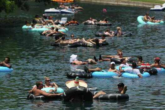 People float in inner tubes down the Comal River in New Braunfels, Texas Sunday May 8, 2011. Photo: SAN ANTONIO EXPRESS-NEWS