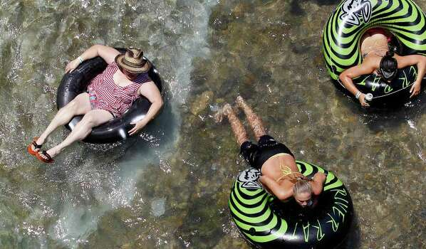Tubers float the Comal River as Memorial Day Weekend marks the beginning of summer, Friday, May 27, 2011, in New Braunfels, Texas. Photo: AP