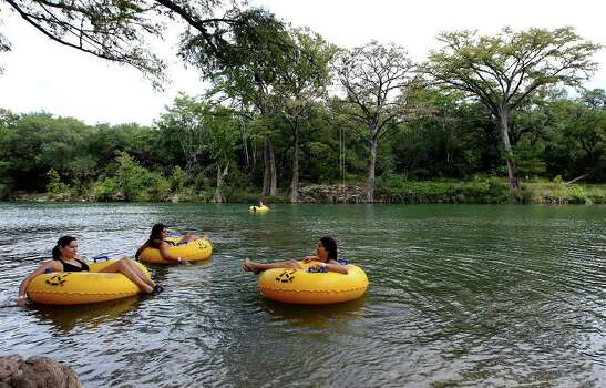 San Antonians Candace Price (left) relaxes on the Guadalupe River at Camp Huaco Springs with her daughters Lauren Moreno (center) and Daniella Gonzalez (right) on Labor Day on Monday, Sept. 6, 2010. Kin Man Hui/kmhui@express-news.net Photo: KIN MAN HUI, SAN ANTONIO EXPRESS-NEWS / San Antonio Express-News