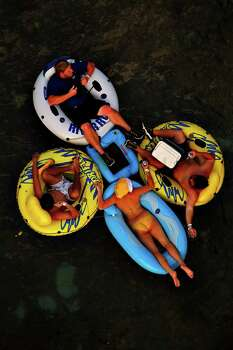 People tube on the Comal River in New Braunfels,  Saturday, May 24, 2008. NICOLE FRUGE/nfruge@express-news.net Photo: NICOLE FRUGE, SAN ANTONIO EXPRESS-NEWS / nfruge@express-news.net