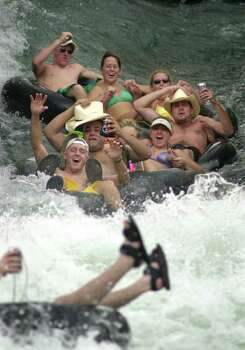 METRO DAILY - A group of tubers from Surfside go down the Prince Solms Park Tube Shute into the Comal river Sunday, August 2, 2001 in New Braunfels. Labor day weekend, which heralds the end of summer, is the last big weekend of tubing in the area.   BAHRAM MARK SOBHANI/STAFF Photo: BAHRAM MARK SOBHANI, SAN ANTONIO EXPRESS-NEWS