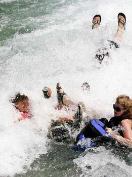 Tubers go through rapids as they exit a chute on the Comal River on Labor Day weekend, Sunday, Sept. 4, 2011.  The New Braunfels Police Department beefed up their weekend patrol from a unit of six to over 40 officers to insure public safety on the river. Photo: JERRY LARA, Jerry Lara/Express-News / SAN ANTONIO EXPRESS-NEWS