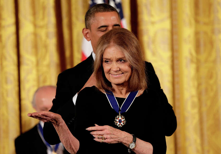 U.S. President Barack Obama awards the Presidential Medal of Freedom to Gloria Steinem in the East Room at the White House on November 20, 2013 in Washington, DC. The Presidential Medal of Freedom is the nation's highest civilian honor, presented to individuals who have made meritorious contributions to the security or national interests of the United States, to world peace, or to cultural or other significant public or private endeavors. Photo: Win McNamee, Getty Images / 2013 Getty Images