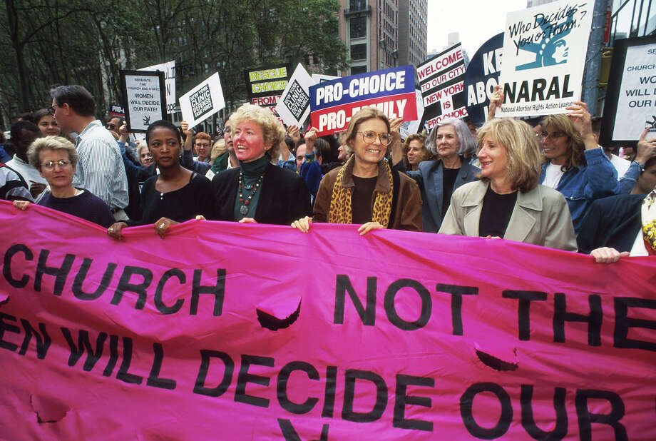 National Abortion and Reproductive Rights Action League leader Kelli Conlin, feminist Gloria Steinem, actress Olympia Dukakis and other protestors hold up a banner at the Women's Rights rally October 7, 1995 in New York City. The rally protested the arrival of Pope John Paul II, whose conservative doctrine on issues such as abortion, sex, and homosexuality contradict the ideology of many women's rights groups. Photo: Evan Agostini, Getty Images / Hulton Archive