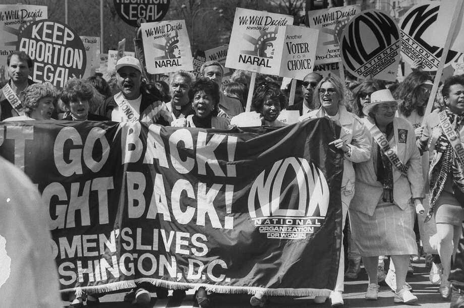 Journalist Gloria Steinem, third from right, and others carrying large NOW pro choice banner during march in Washington in 1992. Photo: Robert Sherbow, Getty Images / Robert Sherbow