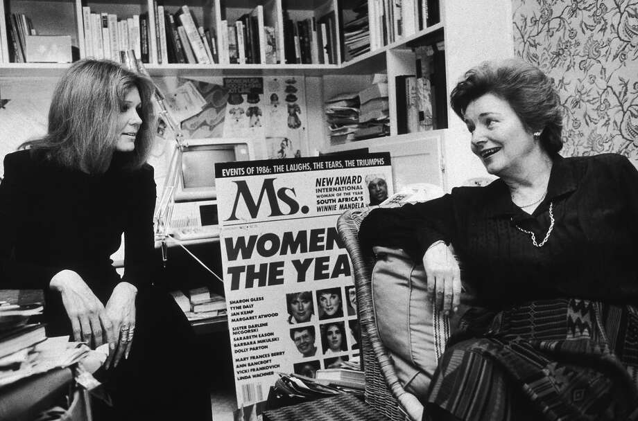 American feminist activists and writers Gloria Steinem (L) and Patricia Carbine, cofounders of Ms. Magazine, talking in an office. The pair were seeking capital to redesign the magazine. Photo: Angel Franco, Getty Images / Archive Photos