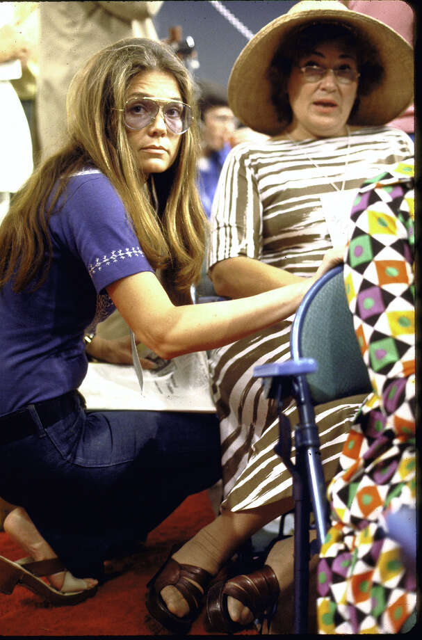 Gloria Steinem kneeling down beside Bella Abzug during the Democratic Convention in 1972. Photo: Bill Eppridge, Getty Images / Time & Life Pictures/Getty Images