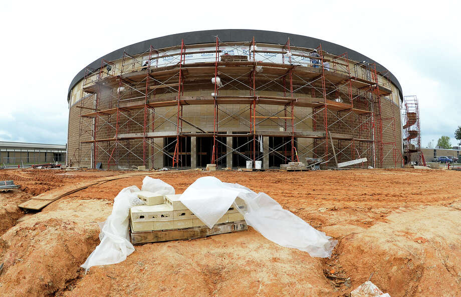 Construction at the Performing Arts Center and FEMA Dome being built next to Lumberton High School. Workers have begun paying brick around the outside of the dome. WIth $5.5 million raised to complete the structure, officials are searching for another $4 million to complete the project. Project completion is currently scheduled for December.  Photo taken Wednesday, March 19, 2014 Guiseppe Barranco/@spotnewsshooter Photo: Guiseppe Barranco, Photo Editor