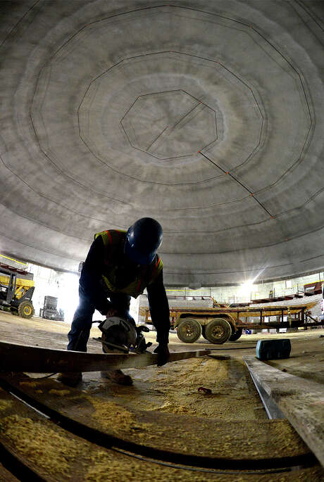 Dario Hernandez cut a plank with a saw at the Performing Arts Center and FEMA Dome being built next to Lumberton High School on March 19, 2014. The dome was completed in 2015 and will serve as a shelter for first responders during disaster situations. Photo: Guiseppe Barranco, Beaumont Enterprise