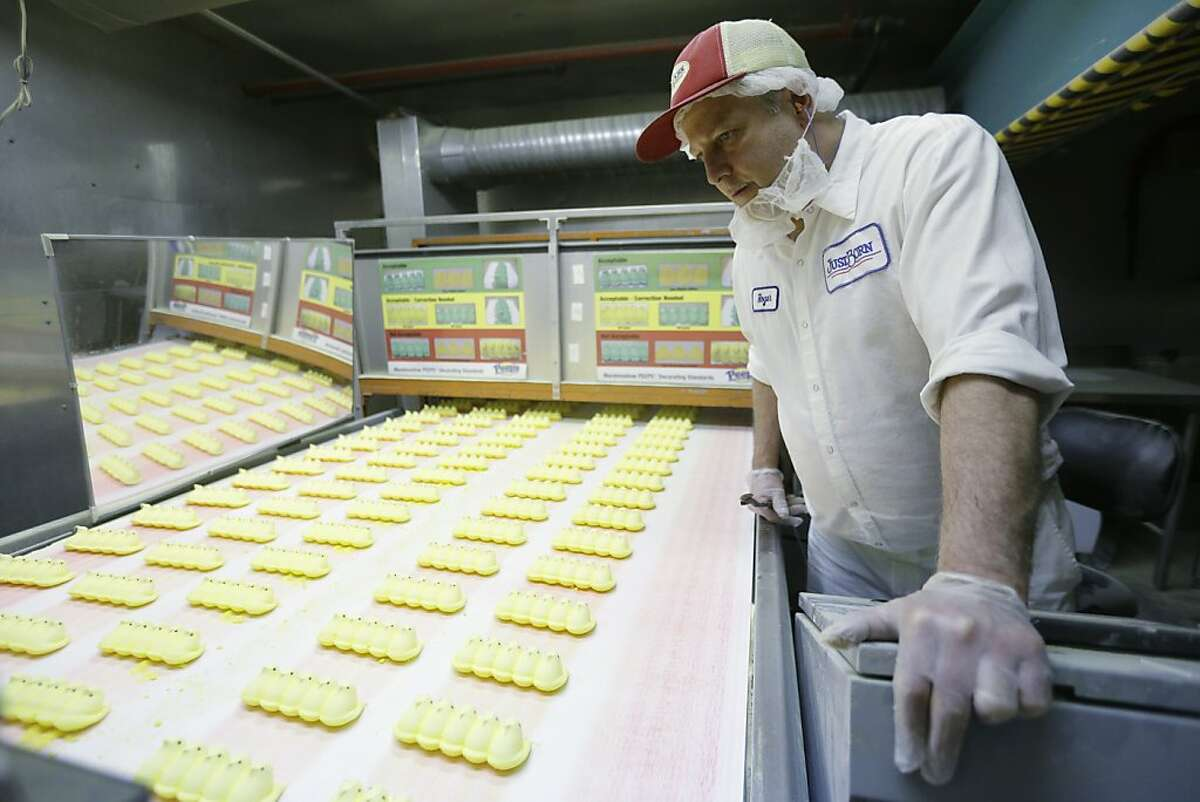 Roger Hildebeitel inspects Peeps as they move through the manufacturing process at the Just Born factory Wednesday, Feb. 13, 2013, in Bethlehem, Pa. (AP Photo/Matt Rourke)