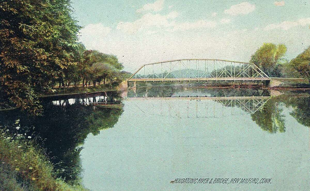 Flashback Spanning the Housatonic Courtesy of Dennis Kenny This rustic image of a steel-trussed bridge spanning the Housatonic River in New Milford graces a vintage postcard printed in German.