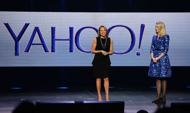 TO GO WITH AFP STORY by Rob LEVER, US-media-industry-IT-Internet (FILES) Katie Couric (L) appears on stage with Yahoo CEO Marissa Mayer during Mayer's keynote address at the 2014 International CES in Las Vegas, Nevada, in this January 7, 2014 file photo. Couric will be Yahoo's