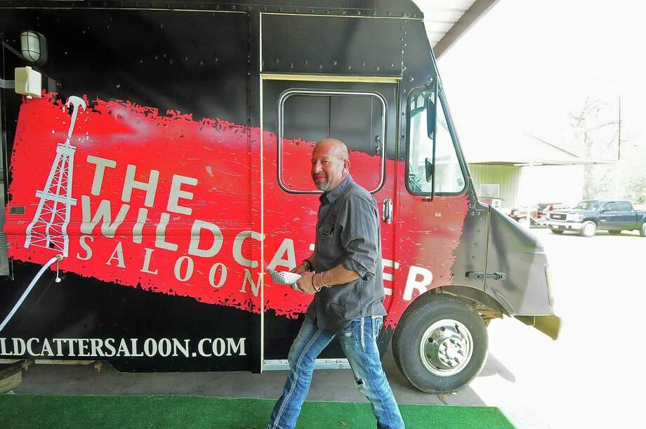 "The Wildcatter Saloon owner Jeff Simon passes the truck where  food is prepared for the bar. The business was just revamped during a ""Bar Rescue"" episode on Spike TV.    The Wildcatter Saloon owner Jeff Simon passes the truck where  food is prepared for the bar. The business was just revamped during a ""Bar Rescue"" episode on Spike TV. Photo: Â Tony Bullard 2014, Freelance Photographer / © Tony Bullard & the Houston Chronicle"