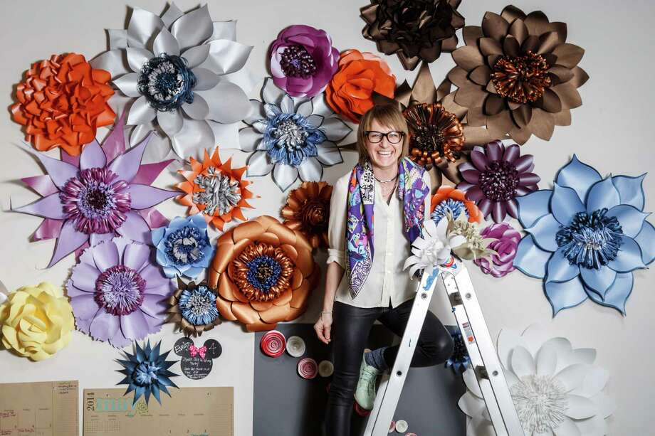 Khrystyna Balushka poses for a photo at Balushka Paper Floral Artistry studio space, Thursday, March 20, 2014, in Houston. ( Michael Paulsen / Houston Chronicle ) Photo: Michael Paulsen, Staff / © 2014 Houston Chronicle