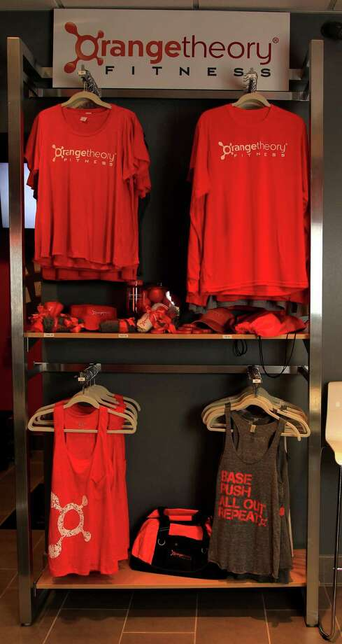 T-shirts and other items for sale at Orangetheory Fitness, 6415 San Felipe, Tuesday, March 18, 2014, in Houston. Orangetheory Fitness is a new fitness studio in Houston, It's based on a group interval fitness, broken into intervals of cardiovascular and strength training, using a variety of equipment including treadmills, rowing machines, SBT suspension training and free weights. ( Karen Warren / Houston Chronicle  ) Photo: Karen Warren, Staff / © 2014 Houston Chronicle