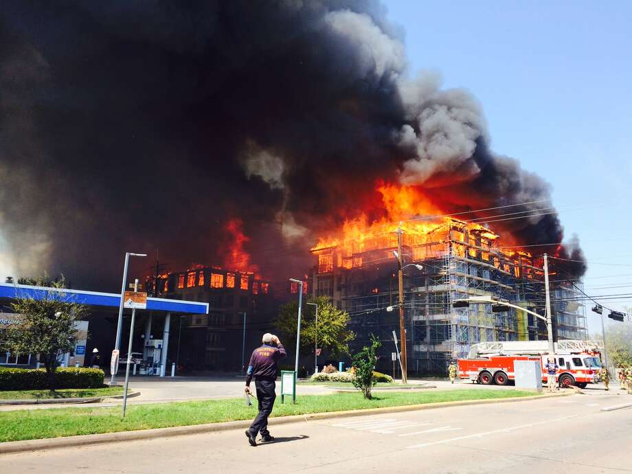 Firefighters are battling a large blaze Tuesday afternoon at an  apartment building just west of downtown. The fire broke out about 12:30  p.m. on West Dallas near Montrose, according to the Houston Fire  Department. Photo: Eric Kayne, Houston Chronicle