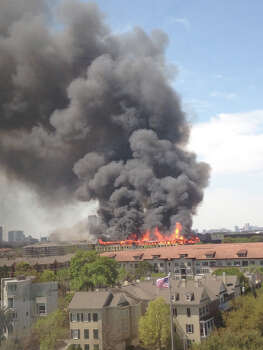 Firefighters are battling a large blaze Tuesday afternoon at an  apartment building just west of downtown. The fire broke out about 12:30  p.m. on West Dallas near Montrose. Photo: Adrienne Shiman, Special To The Houston Chronicle