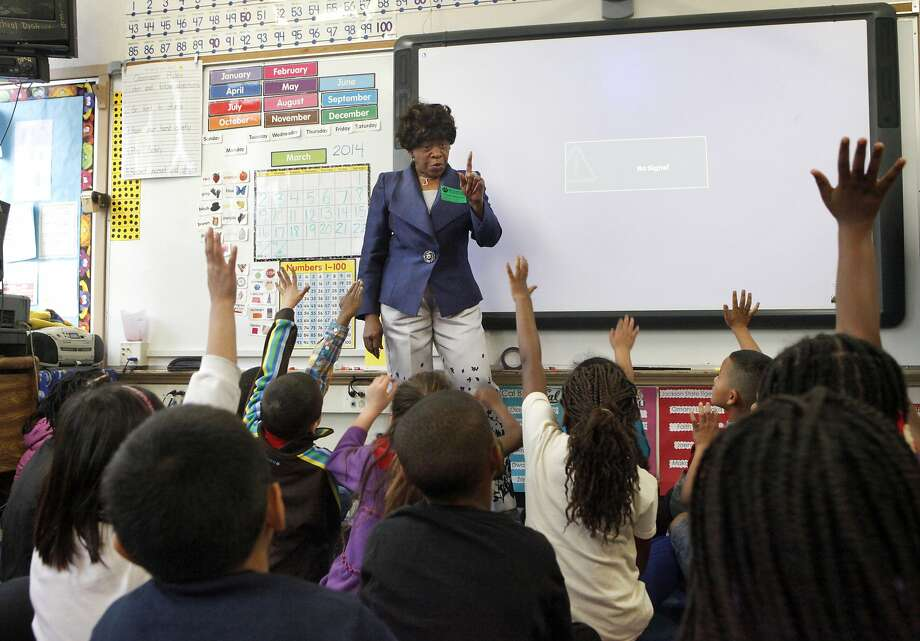 Oral Lee Brown visits with first-graders at Brookfield Elementary, where she first adopted a class in 1987. Photo: Leah Millis, The Chronicle