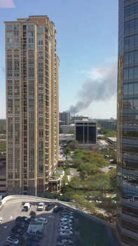 Firefighters are battling a large blaze Tuesday afternoon at an  apartment building just west of downtown. The fire broke out about 12:30  p.m. on West Dallas near Montrose. Photo: Mike Smith, Special To The Houston Chronicle