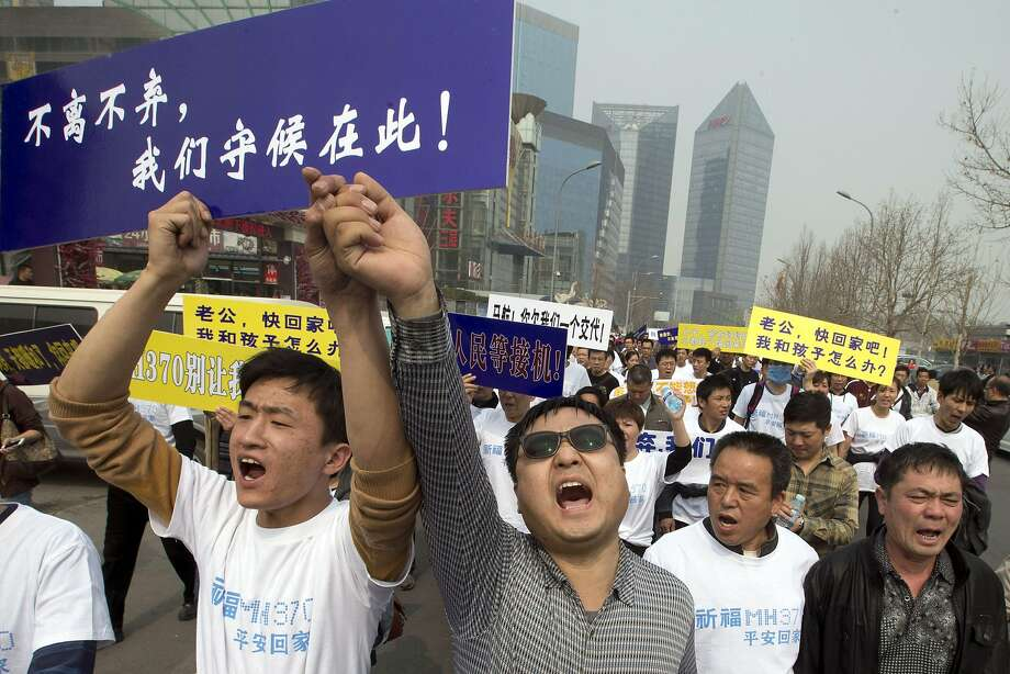 "Relatives of missing passengers march on the Malaysian Embassy in Beijing while shouting, ""Liars!"" Photo: Ng Han Guan, Associated Press"