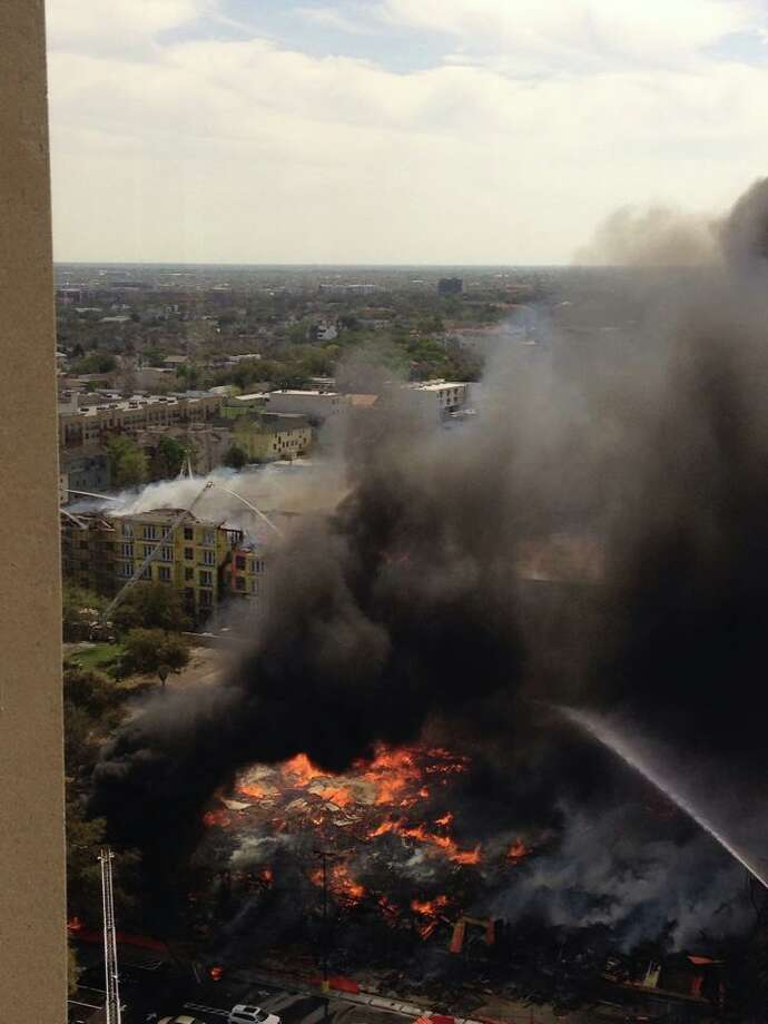 Firefighters battled a 5-alarm blaze at a Montrose-area apartment complex Tuesday aftermoon. Photo submitted by Ginny Mock Photo: Submitted By Ginny Mock
