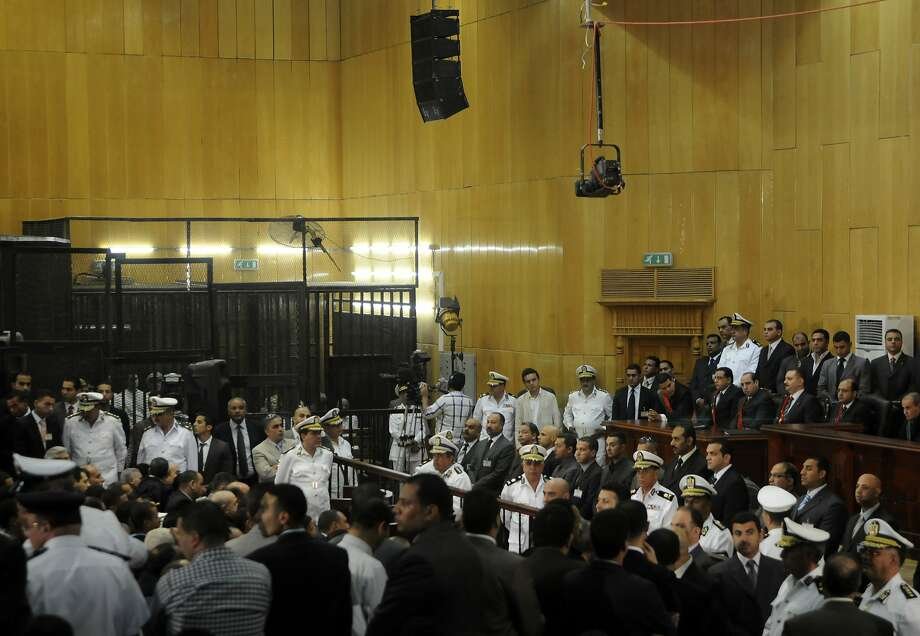FILE - In this Saturday, June 2, 2012 file photo, people gather inside a courtroom to hear a verdict in the trial of former Egyptian President Hosni Mubarak, his sons and several security officers in Cairo, Egypt, Saturday, June 2, 2012.  A verdict sentencing more than 520 people to death on Monday, March 24, 2014 after a cursory mass trial has drawn new attention on Egypt's judiciary, where many judges are strong backers of the military and sharp opponents of Islamists, operating amid a media frenzy calling for swift and harsh verdicts against the Muslim Brotherhood.(AP Photo, File) Photo: Anonymous, Associated Press