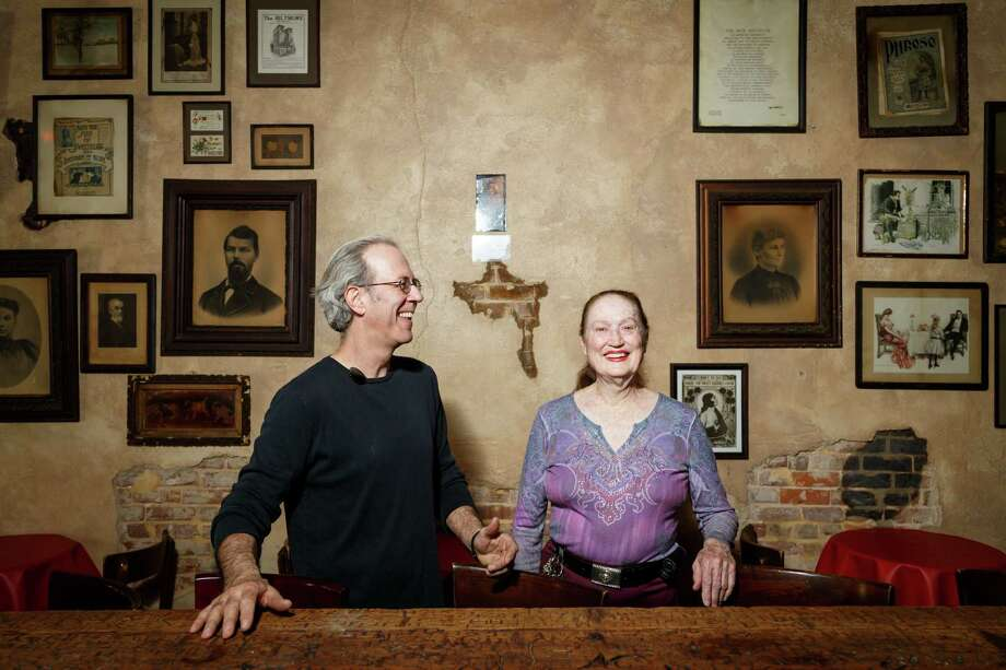 Ted Brown, left, and La Carafe owner Carolyn Wenglar pose for a photo at La Carafe, Friday, March 21, 2014, in Houston. Since 1960, a life-size painting of a woman named Gladys Knox has been hanging in La Carafe, the oldest commercial property in the city that has been in continuous use. The early 20th-century painting is believed to be the work of Scottish painter Sir James Guthrie. Over the years the painting has collected a layer of grime on the canvas and was sent to be cleaned and restored. ( Michael Paulsen / Houston Chronicle ) Photo: Michael Paulsen, Staff / © 2014 Houston Chronicle