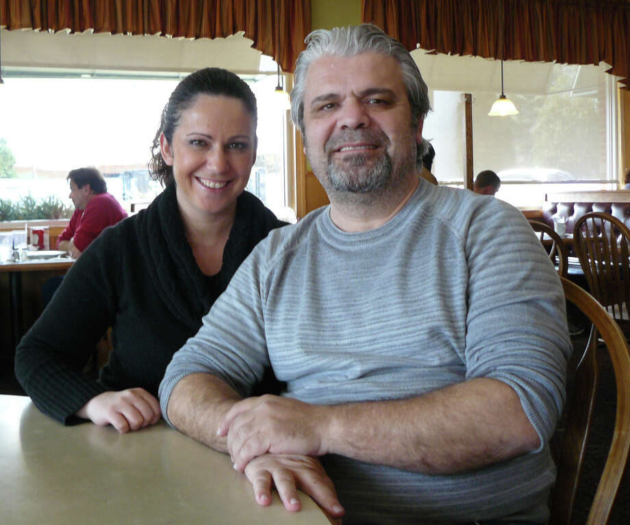George Chatzopoulos and his sister Dina Chatzopoulos Bajko help local chairites raise funds year round in their Chip's Family restaurants.They were recognized recently for their fundraising efforts by the Connecticut House of Representatives. Photo: Staff Photo/Gretchen Webster / Fairfield Citizen