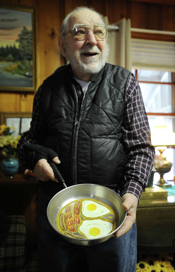 Ralph Bocchetta, of Stamford, has spent over twenty years in retirement creating a variety of whimsical, interactive artistic works, often using materials acquired at tag sales. Here a frying pan painted with eggs, bacon, and sausage links. Photo: Brian A. Pounds / Connecticut Post