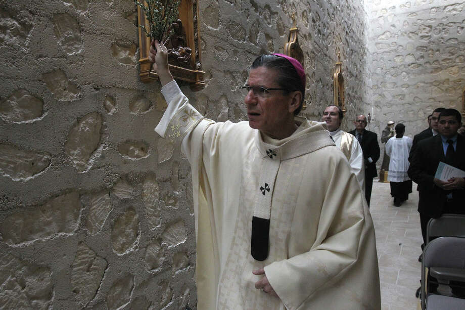 San Antonio Archbishop Gustavo Garcia-Siller blesses the interior of the Chapel of the Solemnity of the Annunciation Tuesday March 25, 2014 during a special Mass held there to celebrate the chapel's recent $1.3 million renovation. The original chapel was dedicated in 1970. Photo: JOHN DAVENPORT, SAN ANTONIO EXPRESS-NEWS / ©San Antonio Express-News/Photo may be sold to the public
