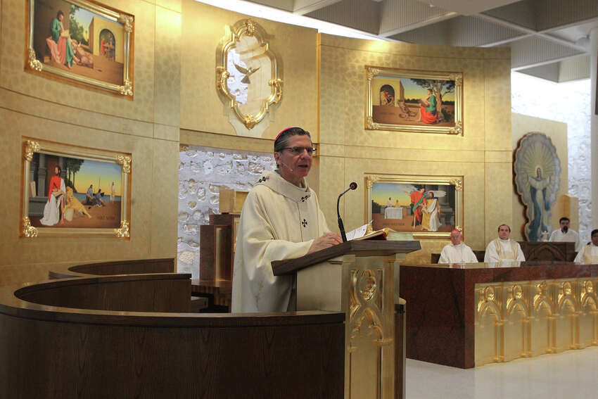 San Antonio Archbishop Gustavo Garcia-Siller (left) speaks in the Chapel of the Solemnity of the Annunciation Tuesday March 25, 2014 during a special Mass held there to celebrate the chapel's recent $1.3 million renovation. The original chapel was dedicated in 1970.
