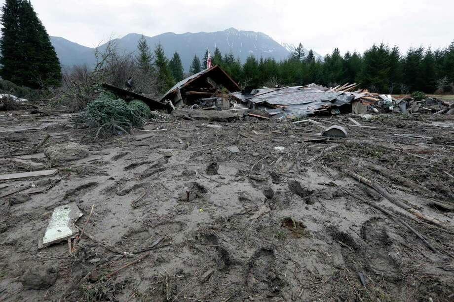 Footprints from searchers remain in mud at the edge of a deadly mudslide Tuesday in Oso. Photo: Elaine Thompson, Associated Press / AP2014