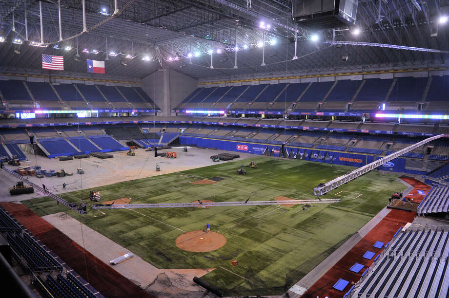 The view of the Alamodome as it will be configured for the Major League Weekend exhibitions games Friday and Saturday.  Because of anticipated heavy traffic and downtown construction, fans attending this weekend's MLB exhibition games between the Texas Rangers and Houston Astros at the Alamodome are being advised to arrive 90 minutes before the first pitch. H-E-B Big League Weekend pits the Rangers against the Astros at 7:05 p.m. Friday and again at 1:05 p.m. Saturday at the dome. Parking is limited so fans are encouraged to either purchase permits in advance at the dome box office (weekday hours 10 a.m.-5 p.m.) or use VIA Park and Ride. Park and Ride is $5 roundtrip, with discounts available, from the Crossroads, Madla Transit Center and Airport locations. Return service runs 45 minutes after end of each game. Photo: Robin Jerstad