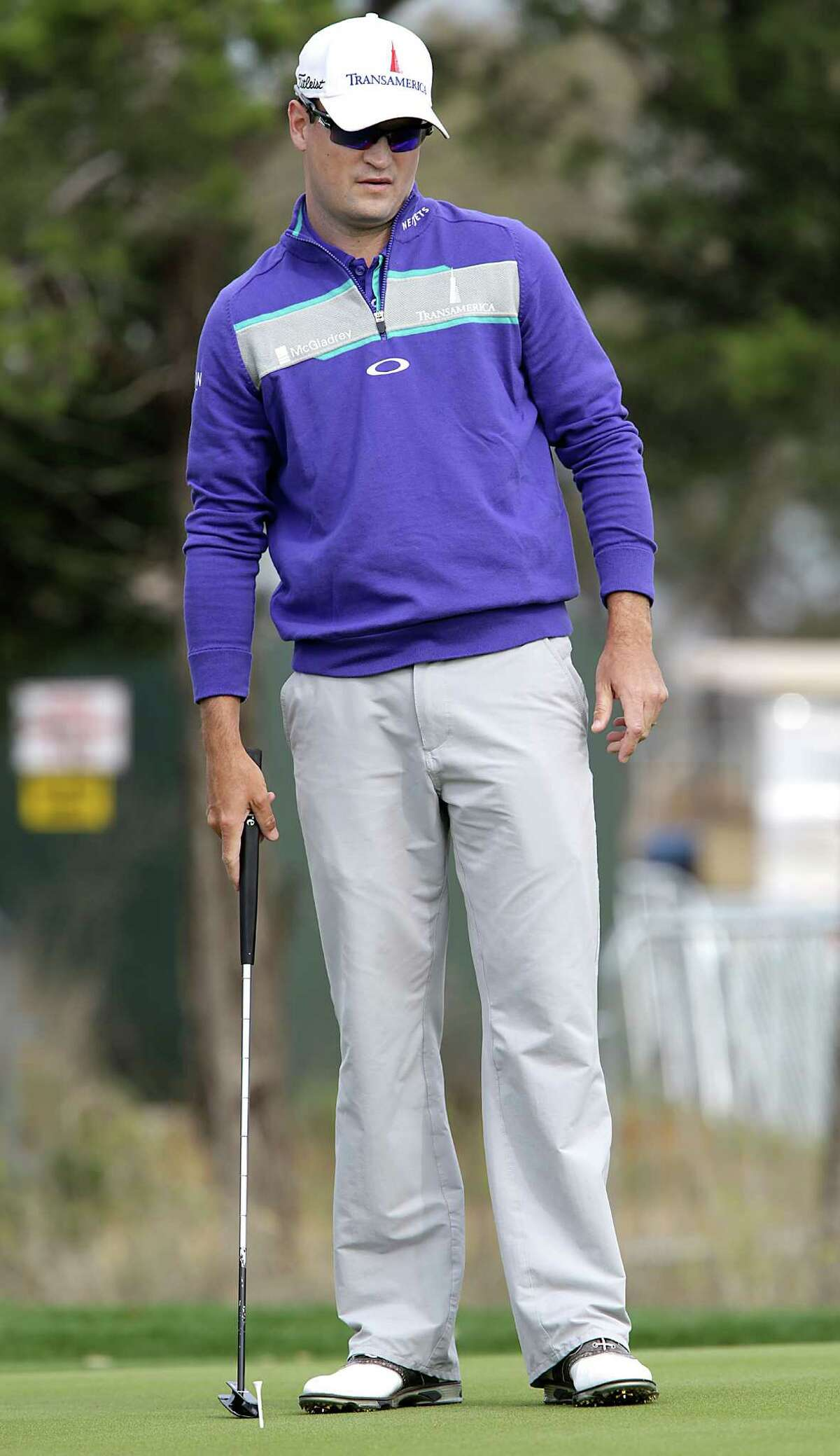 Zack Johnson watches a putt on the practice green as he prepared for the 2014 Valero Texas Open on the TPC San Antonio AT&T Oaks Course. Tuesday, March 25, 2014.