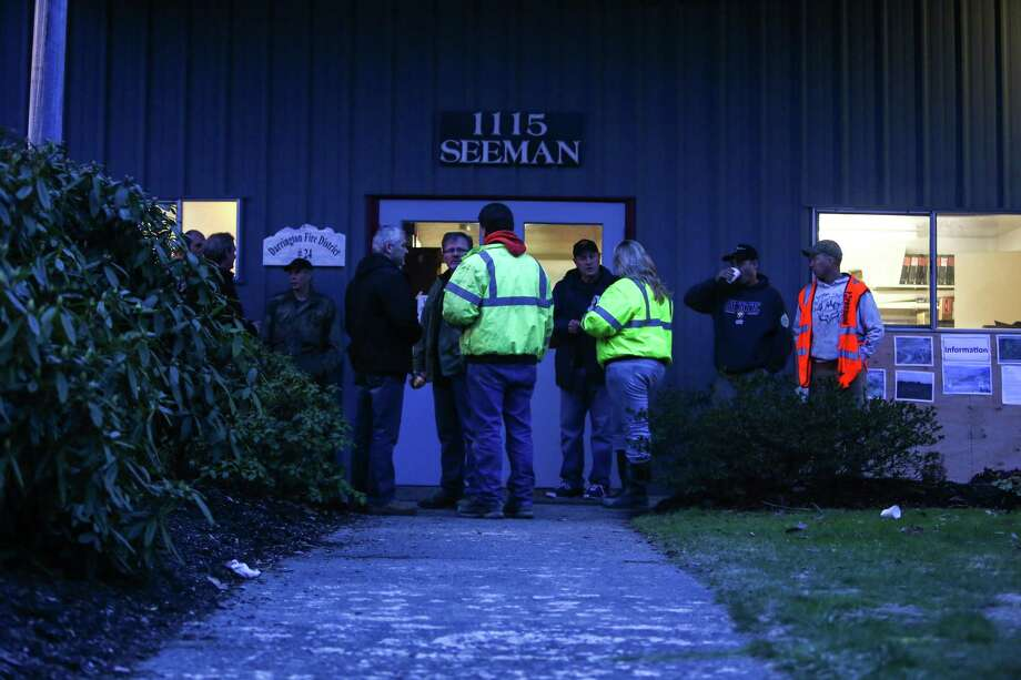 Volunteer rescue workers line up early in the morning at the Darrington, Wash. Fire Department after a call was put out for help from local residents in the search operation. Later in the day rescuers put out a more specific call for loggers and people that operate heavy machinery.  Photo: JOSHUA TRUJILLO, SEATTLEPI.COM / SEATTLEPI.COM