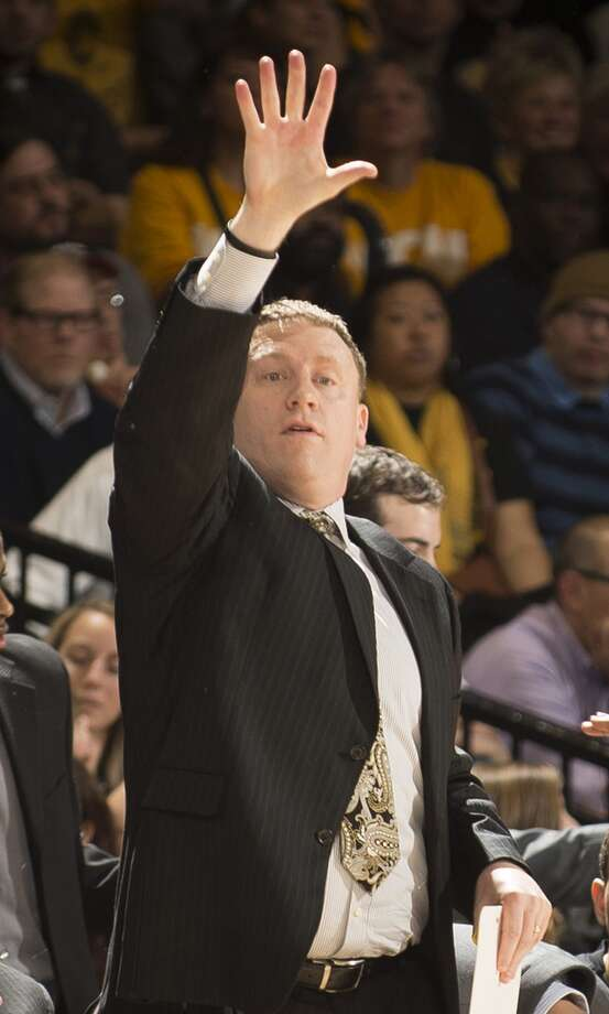 Mike Rhoades has served as an assistant for Shaka Smart since 2009. (Scott K. Brown/ Getty Images)