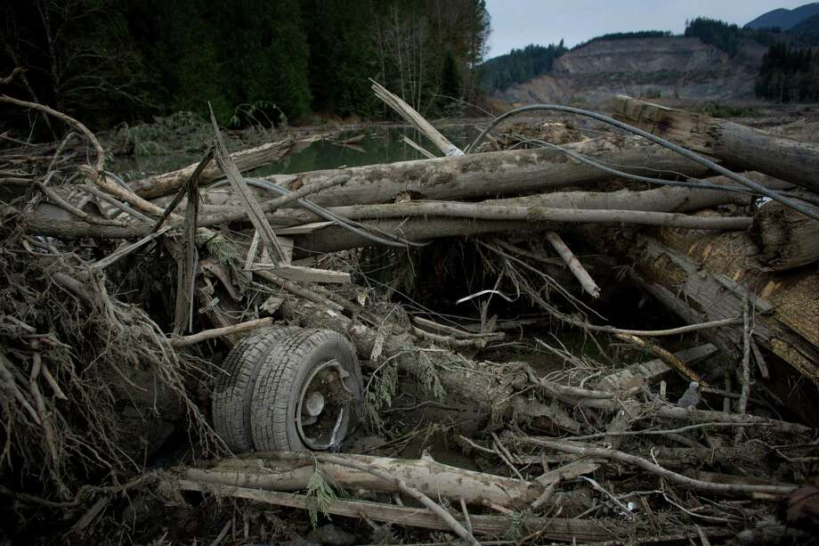 The rear wheels of a truck are shown in the mudslide debris near Oso, Wash. Photo: JOSHUA TRUJILLO, SEATTLEPI.COM / SEATTLEPI.COM