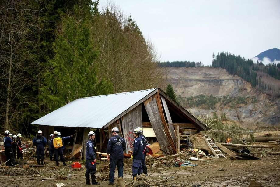 Members of the FEMA National Response Team survey the damage. Photo: JOSHUA TRUJILLO, SEATTLEPI.COM / SEATTLEPI.COM