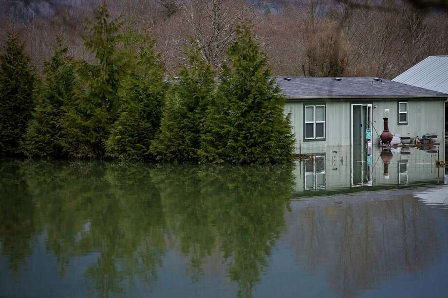 A home flooded by the backed up North Fork of the Stillaguamish River is shown near Oso, Wash. Some homes east of the slide escaped the slide but were flooded by the backed up river. Photo: JOSHUA TRUJILLO, SEATTLEPI.COM / SEATTLEPI.COM
