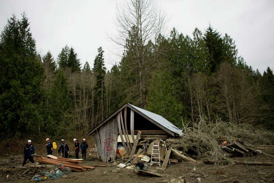 Members of the FEMA National Response Team survey the damage near Oso, Wash. Photo: JOSHUA TRUJILLO, SEATTLEPI.COM / SEATTLEPI.COM